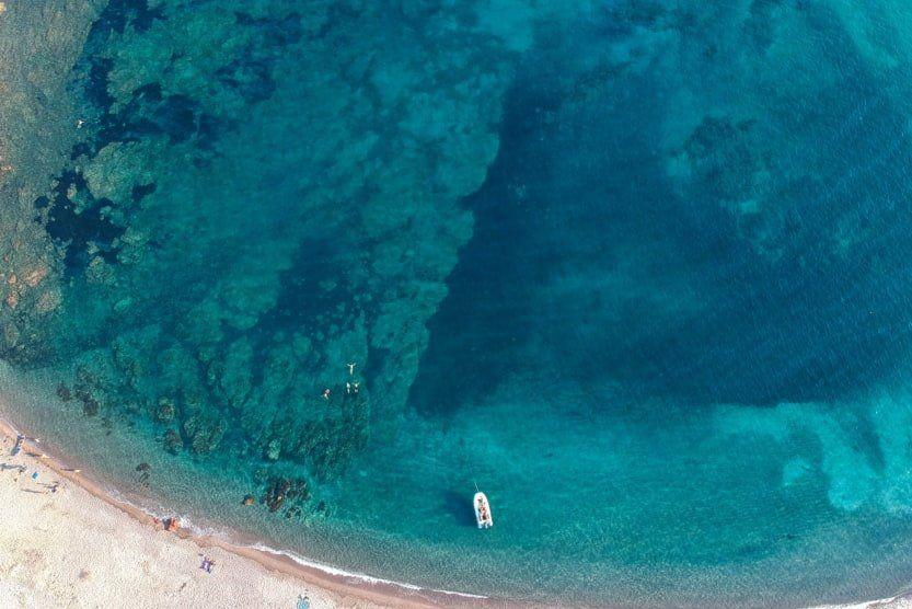 best-beaches-north-corsica-bay-boat