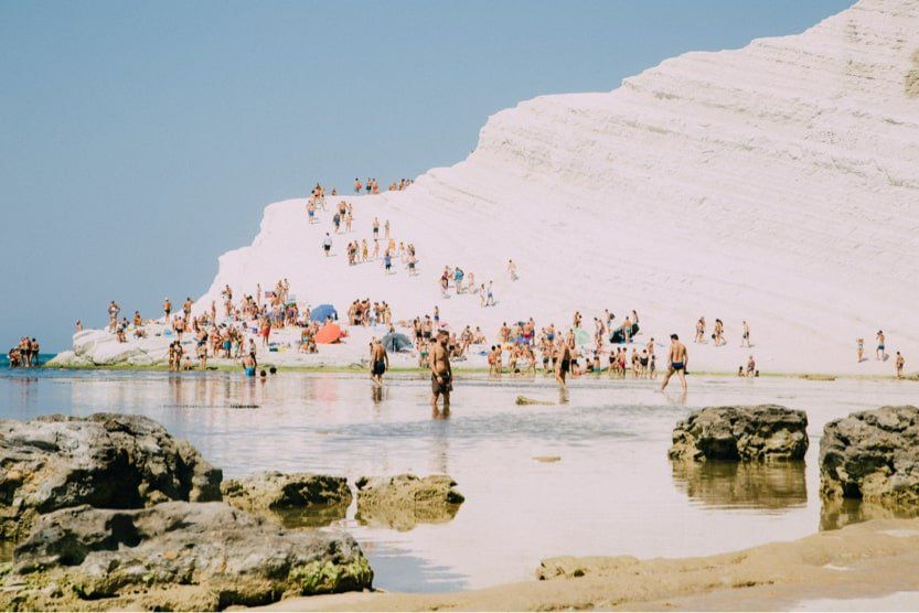 best-places-to-visit-in-Italy-in-summer-swim-sicily-min