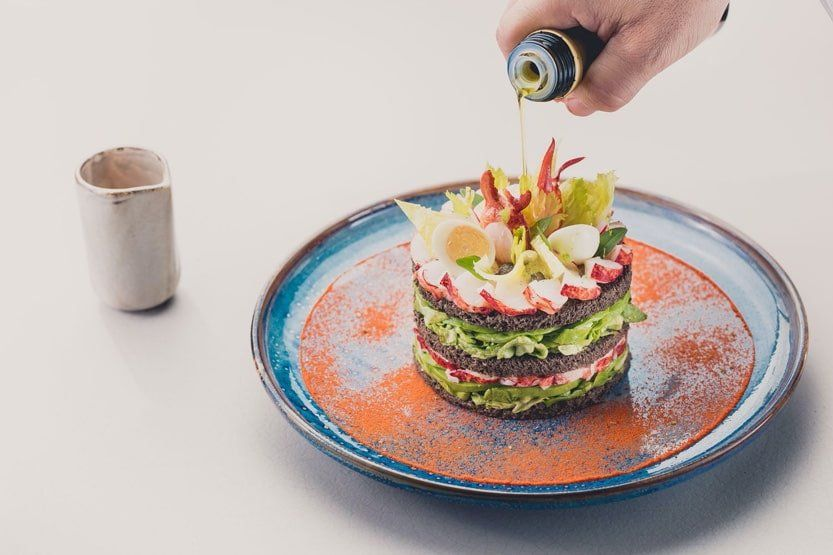 Dine at the table at Hotel Byblos St Tropez